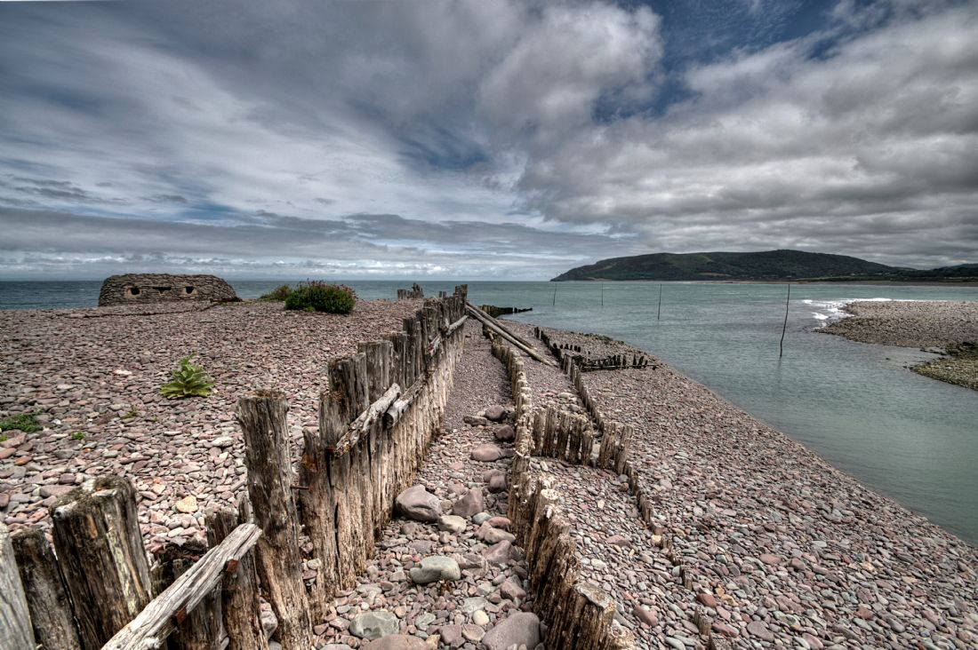 Rosie Spooner | Old wooden groynes at Porlock Weir in Somerset.