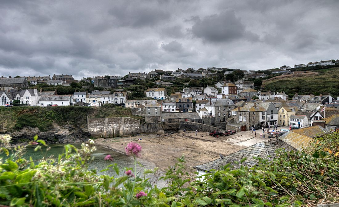 Rosie Spooner | Cloudy day over Port Isaac viewed from the coast path