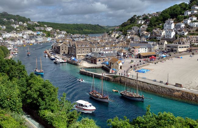 Rosie Spooner | Luggers head down the Looe River for the Lugger Regatta