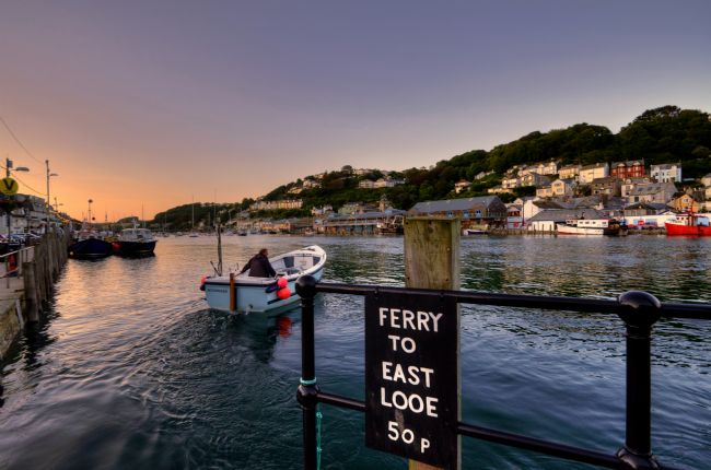 Rosie Spooner | Ferry across the River Looe  as the sun sets in Cornwall