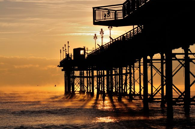 Rosie Spooner | Teignmouth Pier at sunrise in South Devon