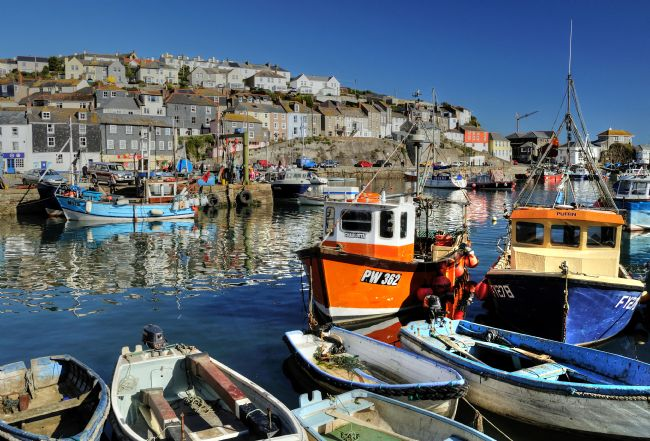 Rosie Spooner | Reflections of the colourful houses and boats at Mevagissey in Cornwall