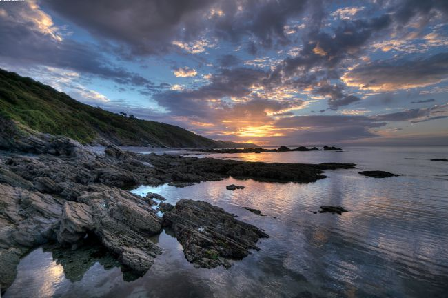 Rosie Spooner | Millendreath Beach at sunrise at Looe in Cornwall