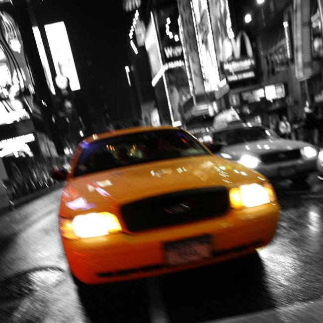 David Richardson | Blurred yellow cab in Times Square