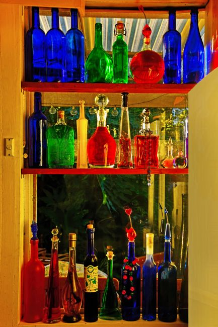 Kaye Menner | Window of Colorful Bottles