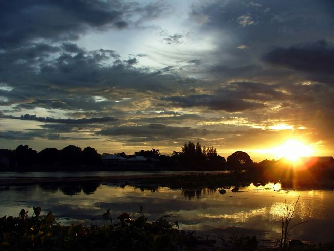 Serena Bowles | Sunset on the River Kwai, Kanchanaburi, Thailand