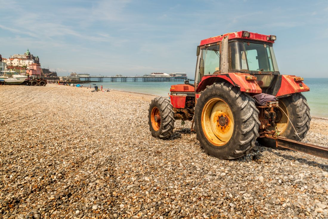 Stephen Mole | Red tractor on Cromer Beach
