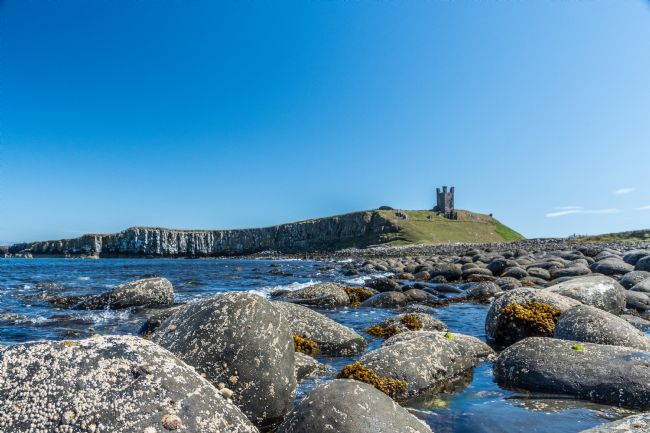 Mike Carroll | Dunstanburgh Castle from the tide line