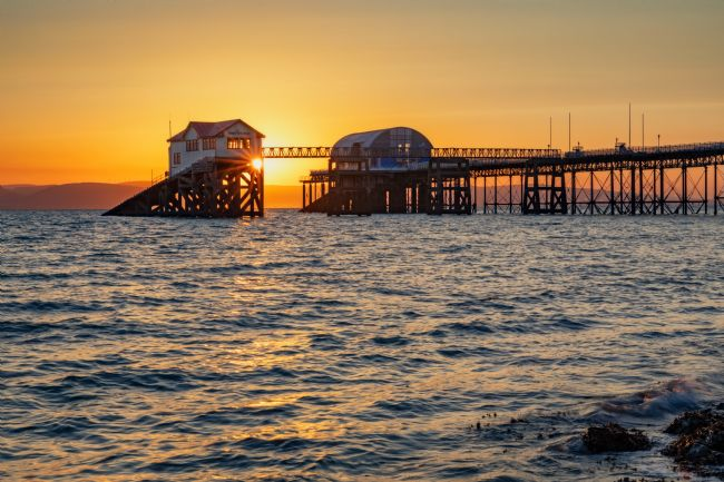 Dan Santillo | Sunrise between the old and new Mumbles Lifeboat Stations