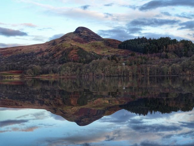 yvonne carroll | A stunning mirror image reflection of Conic Hill taken from Loch Lomond