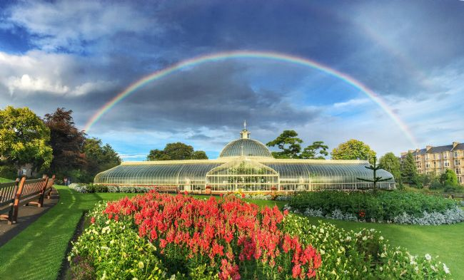 yvonne carroll | Glasgow's Botanic Gardens in summer after the rain with blue sky and a full rainbow over the Kibble Palace