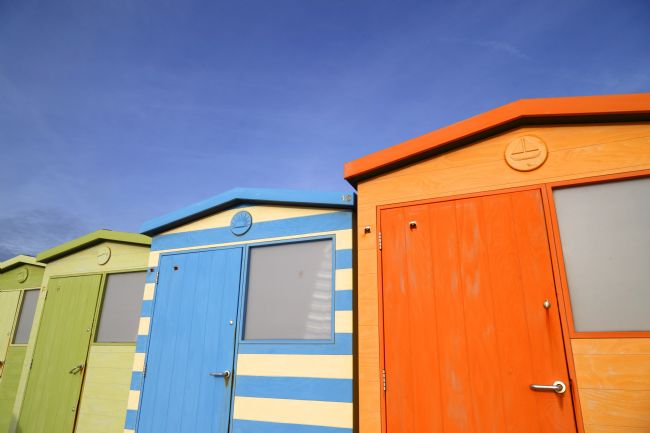 James Brunker | Brightly Coloured Beach Huts Seaford East Sussex