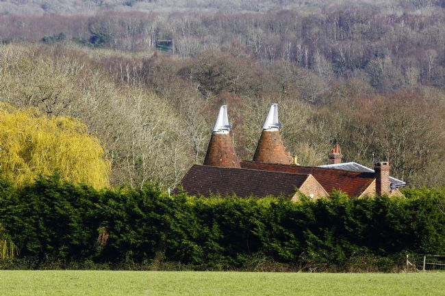 James Brunker | Oast House and High Weald Woods in Early Spring Kent