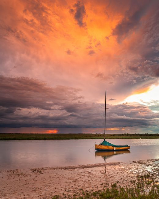David Powley | Stormy sunset at Blakeney Harbour