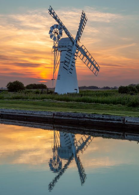David Powley | Sunset Reflections at Thurne Mill