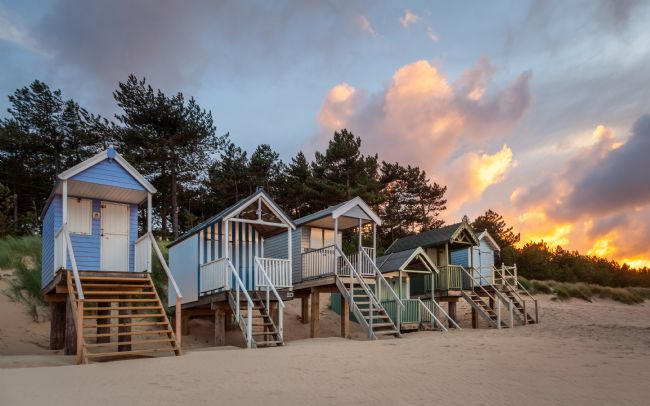 David Powley | Evening Light on the Beach Huts at Wells Norfolk