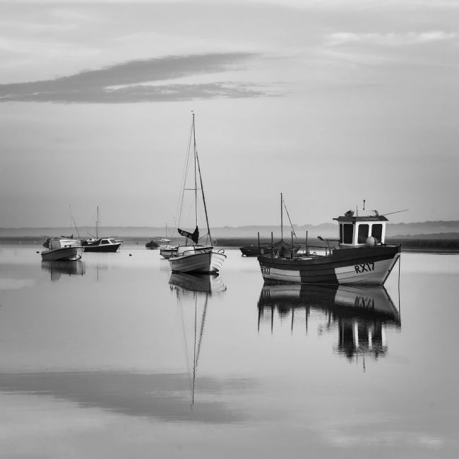 David Powley | Morning Reflections at Brancaster Staithe Norfolk Mono