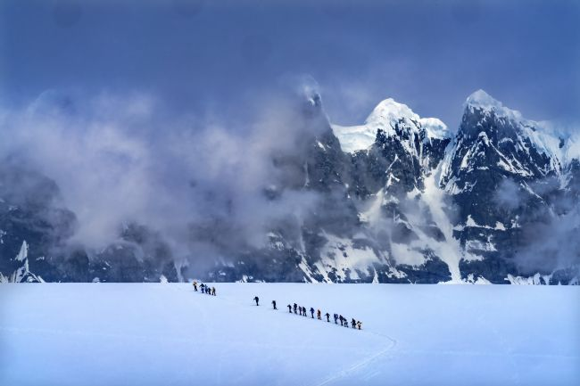 William Perry | Showshoers Hikers Snow Mountains Damoy Point Antarctica