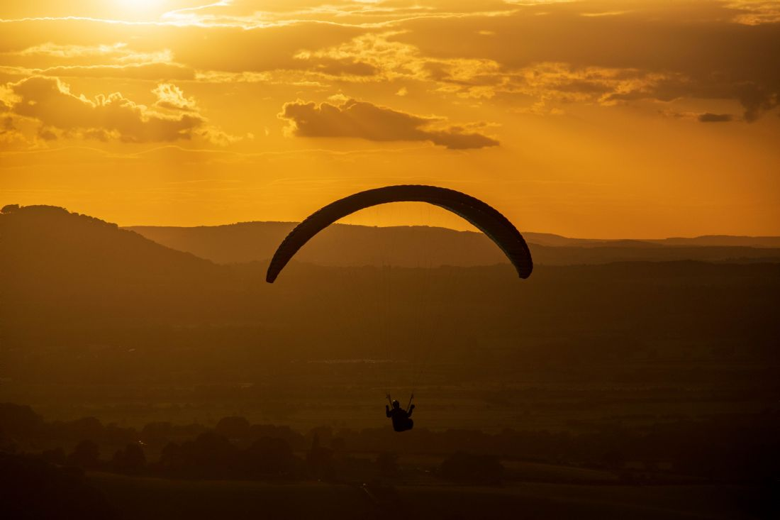 Hannah Temple | Paragliding against the sunset