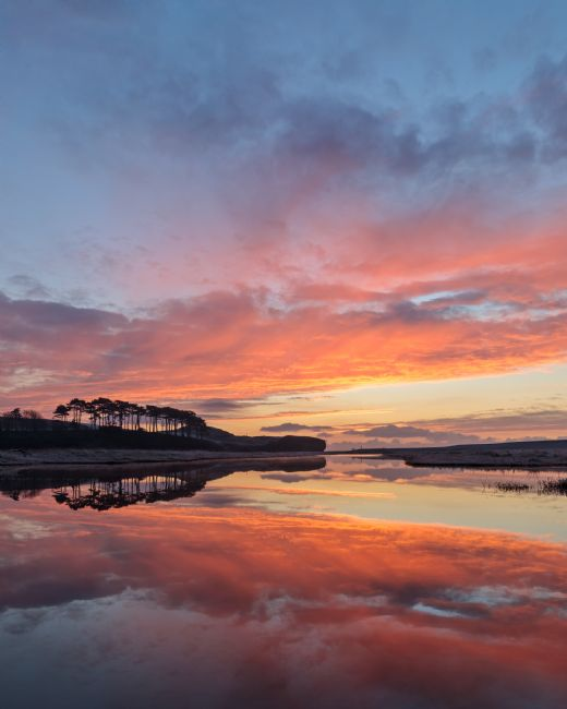 Bruce Little | Dramatic red sky at Budleigh Salterton