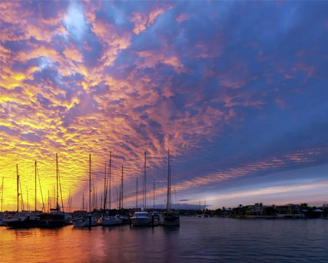 Geoff Ghilds |  Golden cloud nautical sunset silhouettes.