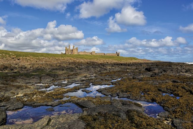 Jon  Jones | Dunstanburgh Castle on the Northumberland coast